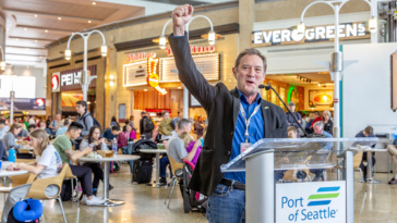 Port Commissioner, Peter Steinbrueck, celebrating the opening of the south side of Sea-Tac's Central Terminal, 29 March 2019.